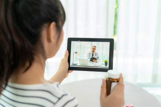 Patient talking to physician about medication on tablet during a TeleCare video call