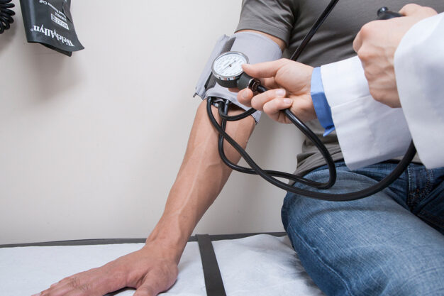 Patient getting Blood Pressure Checked