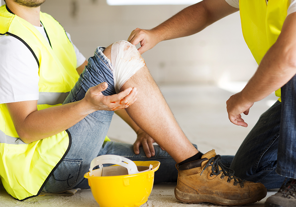 Injured construction worker on job site